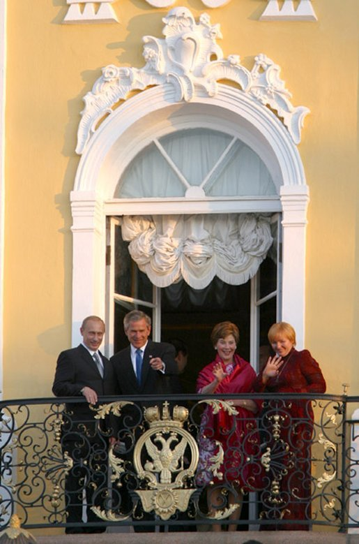 President George W. Bush and Mrs. Laura Bush wave with Russian President Vladimir Putin and wife Lyudmila Putin from the window of Peterhof Palace in St. Petersburg, Russia May 31, 2003. They were taking part in St. Petersburg's 300th anniversary celebration. White House photo by Paul Morse