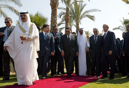 President George W. Bush walks with Red Sea Summit participants from left, King Hamad Bin Issa Al Khalifa of Bahrain, King Abdullah Bin Al Hussein of Jordan, President Hosni Mubarak of Egypt, Prince Abdullah Bin Abd Al Aziz of Saudi Arabia, and Prime Minister Mahmoud Abbas from the Palestinian Delegation prior to giving statements in Sharm El Sheikh, Egypt June 3, 2003. White House photo by Paul Morse.
