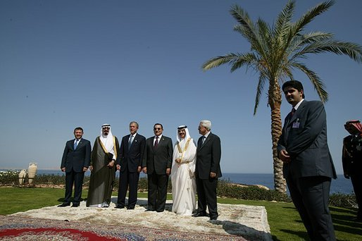 Red Sea Summit participants from left King Abdullah Bin Al Hussein of Jordan, Prince Abdullah Bin Abd Al Aziz of Saudi Arabia, President George W. Bush, President Hosni Mubarak of Egypt, King Hamad Bin Issa Al Khalifa of Bahrain, and Prime Minister Mahmoud Abbas from the Palestinian Delegation pose for a family photo next to the Red Sea in Sharm El Sheikh, Egypt June 3, 2003. White House photo by Paul Morse.