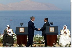 President George W. Bush and President Hosni Mubarak of Egypt after delivering statements on the progress of the Red Sea Summit in Sharm El Sheikh, Egypt June 3, 2003. On the far left sits Prince Abdullah Bin Abd Al Aziz of Saudi Arabia and on the far right sits King Hamad Bin Issa Al Khalifa of Bahrain.  White House photo by Paul Morse