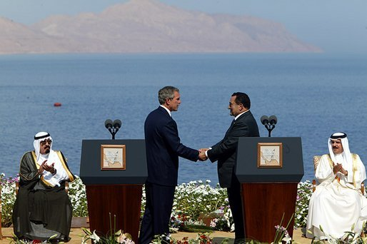 President George W. Bush and President Hosni Mubarak of Egypt after delivering statements on the progress of the Red Sea Summit in Sharm El Sheikh, Egypt June 3, 2003. On the far left sits Prince Abdullah Bin Abd Al Aziz of Saudi Arabia and on the far right sits King Hamad Bin Issa Al Khalifa of Bahrain. White House photo by Paul Morse.