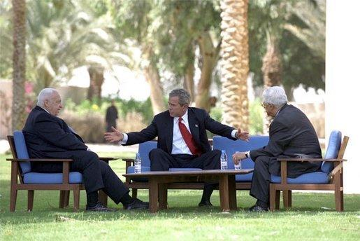 President George W. Bush meets with Prime Minister Ariel Sharon of Israel, left, and Prime Minister Mahmoud Abbas of the Palestinian Authority at Beit al Behar Palace in Aqaba, Jordan, June 4, 2003. White House photo by Eric Draper