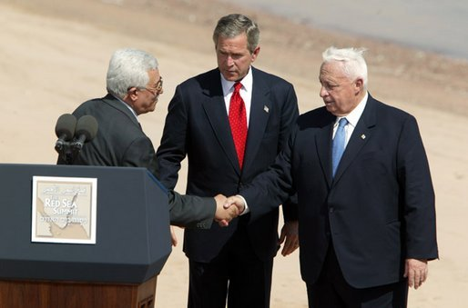 Palestinian Prime Minister Mahmoud Abbas, President George W. Bush and Israeli Prime Minister Ariel Sharon after reading statement to the press during the closing moments of the Red Sea Summit in Aqaba, Jordan Jun 4, 2003. White House photo by Paul Morse