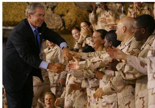President George W. Bush greets troops during his introduction at Camp As Sayliyah in Doha, Qatar, Thursday, June 5, 2003. White House photo by Paul Morse.