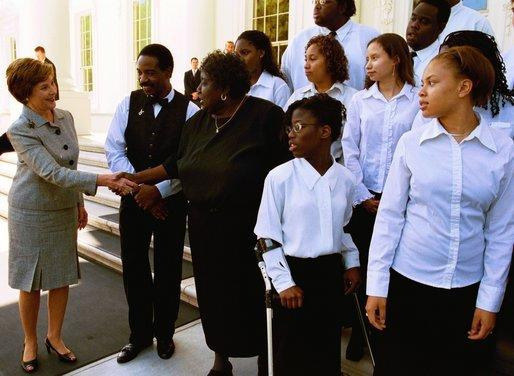 "Laura Bush greets Dr. Blanche Hammond and members of the D.C. High School Choral Group Monday, June 9, 2003. The group performed during, ""The White House: In Tune With History,"" a program celebrating the history of live music performances at the White House. White House photo by Susan Sterner"