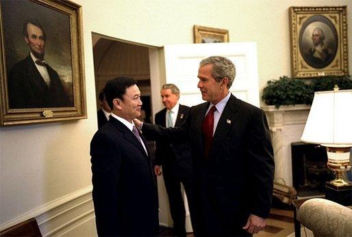 President George W. Bush meets with the Prime Minister Thaksin Shinawatra of Thailand in the Oval Office Tuesday, June 10, 2003. White House photo by Eric Draper