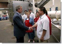 President George W. Bush greets employees of Andrea Foods in Orange, N.J., Monday, June 16, 2003.  White House photo by Eric Draper