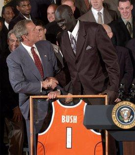 Congratulating the NCAA Winter Championship teams, President George W. Bush stands with Kueth Duany of Syracuse University's mens' basketball team in the East Room Tuesday, June 17, 2003.  White House photo by Tina Hager
