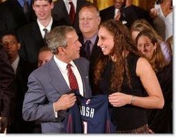 Congratulating the NCAA Winter Championship teams, President George W. Bush stands with Diana Taurasi of the University of Connecticut's women's basketball team in the East Room Tuesday, June 17, 2003.  White House photo by Tina Hager