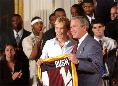 Congratulating the NCAA Winter Championship teams, President George W. Bush stands with Maria Roth of the University of Minnesota-Duluth's women's hockey team in the East Room Tuesday, June 17, 2003. White House photo by Tina Hager