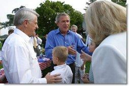 President George W. Bush greets guests at the Congressional Picnic on the South Lawn Wednesday, June 18, 2003.  White House photo by Susan Sterner