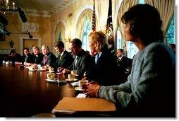 President George W. Bush answers questions from reporters before a bipartisan meeting with senators on Medicare reform in the Cabinet Room Wednesday, June 18, 2003.  White House photo by Paul Morse
