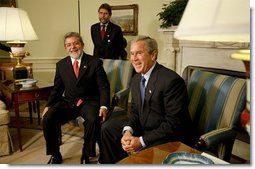 "President George W. Bush and President Luiz Inacio Lula da Silva of Brazil address the media in the Oval Office Friday, June 20, 2003. ""This is the third meeting I will have held with the President. It shows how important our relationship is,"" said President Bush. ""Brazil is an incredibly important part of a peaceful and prosperous North and South America. I can say that from the perspective of the United States, this relationship is a vital and important and growing relationship.""  White House photo by Paul Morse"