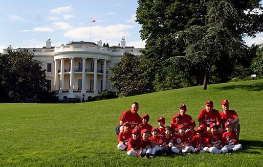 The Fort Belvoir Little League Braves of Fort Belvoir, Va., pose for a team photo after playing tee ball with the Naval Base LIttle League Yankees of Norfolk, Va., on the South Lawn Sunday, June 22, 2003. White House photo by Lynden Steele.
