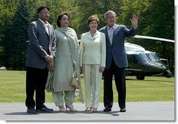President Pervez Musharraf, his wife, Sehba Musharraf, President George W. Bush and Laura Bush stand for a group photo shortly after the press conference at Camp David Tuesday, June 24, 2003.  White House photo by David Bohrer