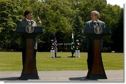 "Presidents Pervez Musharraf of Pakistan and George W. Bush hold a joint press conference at Camp David Tuesday, June 24, 2003. ""Greater economic development is also critical to fulfilling the hopes of the Pakistani people,"" said President Bush. ""Since we met last year, the United States has cancelled $1 billion of debt Pakistan owed our country. And today I'm pleased to announce that our nations are signing a trade and investment framework agreement, which creates a formal structure for expanding our economic partnership.""  White House photo by David Bohrer"