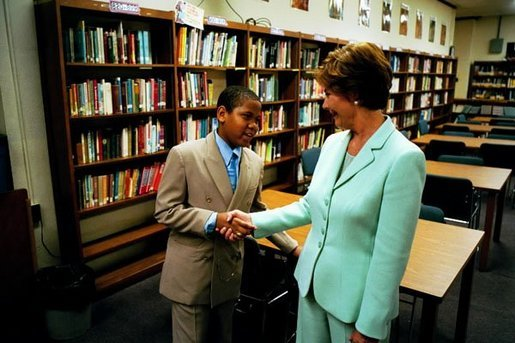 Laura Bush meets a student as she tours the library of Dimner Beeber Middle School in Philadelphia, Pa., June 25, 2003. White House photo by Tina Hager