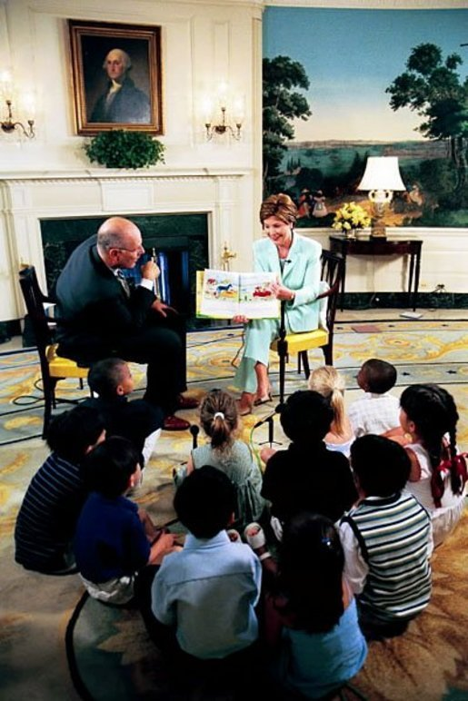 Laura Bush reads to children during an appearance on a morning show broadcast from the Diplomatic Reception Room in the White House, June 25, 2003. White House photo by Susan Sterner