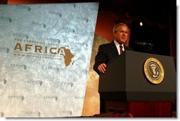 "President George W. Bush addresses the Corporate Council on Africa's U.S.- Africa Business Summit in Washington, D.C., Thursday, June 27, 2003. ""All of us here today share some basic beliefs. We believe that growth and prosperity in Africa will contribute to the growth and prosperity of the world. We believe that human suffering in Africa creates moral responsibilities for people everywhere. We believe that this can be a decade of unprecedented advancement for freedom and hope and healing and peace across the African continent,"" President Bush said.  White House photo by Paul Morse"