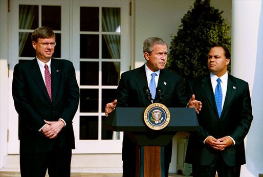"Announcing the national ""Do Not Call Registry,"" President George W. Bush stands with Federal Trade Commission Chairman Timothy Muris, left, and Federal Communications Commission Chairman Michael Powell in the Rose Garden Friday, June 28, 2003. The registry protects privacy by blocking incoming telemarketing calls. White House photo by Susan Sterner"