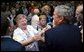 President George W. Bush reacts to a kiss by a senior citizen after speaking about pending Medicare legislation at the Little Havana Activities and Nutrition Center in Miami, Fla., June 30, 2003. White House photo by Paul Morse