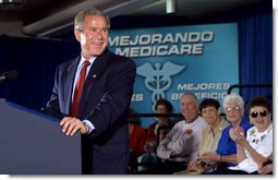 President George W. Bush addresses seniors on pending Medicare legislation at the Little Havana Activities and Nutrition Center in Miami, Fla., June 30, 2003.  White House photo by Paul Morse