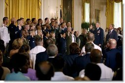 Marking the 30th anniversary of the All-Volunteer Force that constitutes America's military, President George W. Bush watches as Chairman of the Joint Chiefs of Staff General Richard Myers conducts a reenlistment service in the East Room Tuesday, July 1, 2003.  White House photo by Eric Draper