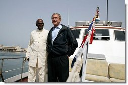 President George W. Bush and President Abdoulaye Wade of Senegal ride aboard the Presidential Yacht to Goree Island, Senegal, Tuesday, July 8, 2003.  White House photo by Paul Morse