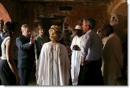 President George W. Bush and Laura Bush tour the Slave House on Goree Island, Senegal, with President Abdoulaye Wade and Viviane Wade of Senegal, Secretary of State Colin Powell, far left, and National Security Advisor Dr. Condoleezza Rice Tuesday, July 8, 2003.  White House photo by Paul Morse
