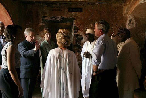 President George W. Bush and Laura Bush tour the Slave House on Goree Island, Senegal, with President Abdoulaye Wade and Viviane Wade of Senegal, Secretary of State Colin Powell, far left, and National Security Advisor Dr. Condoleezza Rice Tuesday, July 8, 2003. White House photo by Paul Morse.
