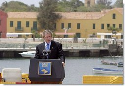 "President George W. Bush delivers remarks after touring Goree Island, Senegal, Tuesday, July 8, 2003. ""For hundreds of years on this island peoples of different continents met in fear and cruelty. Today we gather in respect and friendship, mindful of past wrongs and dedicated to the advance of human liberty,"" said the President.  White House photo by Paul Morse"