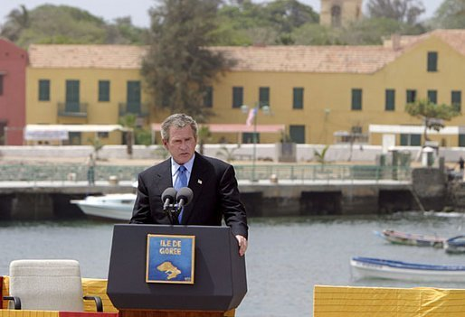 "President George W. Bush delivers remarks after touring Goree Island, Senegal, Tuesday, July 8, 2003. ""For hundreds of years on this island peoples of different continents met in fear and cruelty. Today we gather in respect and friendship, mindful of past wrongs and dedicated to the advance of human liberty,"" said the President. White House photo by Paul Morse."