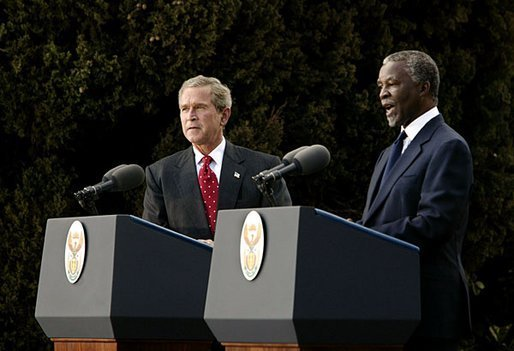 "Presidents Bush and Mbeki speak to the media at the Guest House in Pretoria, South Africa, Wednesday, July 9, 2003. ""I must say, President (Bush), that at the end of these discussions, we, all of us, feel enormously strengthened by your very, very firm and clear commitment to assist us to meet the challenges that we've got to meet domestically and on the African continent,"" said President Mbeki. White House photo by Paul Morse"