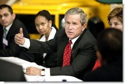 President George W. Bush talks with Ford Motor Company employees at the company's plant near Pretoria, South Africa, Wednesday July 9, 2003.  White House photo by Paul Morse