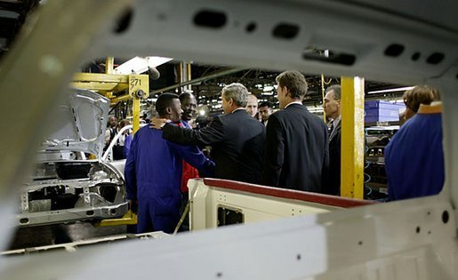 President George W. Bush meets one-on-one with workers at the Ford Motor Company plant near Pretoria, South Africa, Wednesday, July 9, 2003. White House photo by Paul Morse
