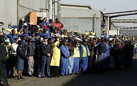 Workers at the Ford Motor Company plant watch as President Bush departs the plant near Pretoria, South Africa, Wednesday July 9, 2003.  White House photo by Paul Morse
