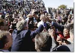 President George W. Bush greets an eager crowd upon his arrival at Sir Seretse Khama International Airport in Gaborone, Botswana, Thursday, July 10, 2003.