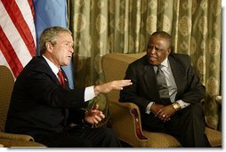 "President George W. Bush begins participation in meeting with the President Festus Magae of Botswana in Gaborone, Botswana, Thursday, July 10, 2003. ""We're thrilled to be here. You have been a very strong leader,"" said President Bush during their joint press conference. ""First, I want to commend you for your leadership. I appreciate your commitment to democracy and freedom, to rule of law and transparency. I want to congratulate you for serving your country so very well.""."