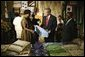 President George W. Bush participates in a tour of the Southern Africa Global Competitiveness Hub with President Festus Gontebanye Mogae of Botswana Thursday, July 10, 2003.