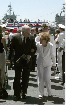 "Vice President Dick Cheney talks with former First Lady Nancy Reagan after the commissioning ceremony for the USS Ronald Reagan in Norfolk, Va., July 12, 2003. ""As we think this afternoon of our 40th President, we think also of the devoted wife at his side,"" Vice President Cheney said during the ceremony. ""Mrs. Reagan, our nation is so grateful to you. You've shared in your husband's great life. And today, you share in the pride of this tribute from the people of the United States of America.""   White House photo by David Bohrer"