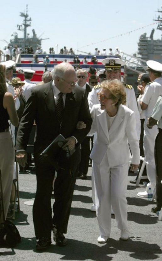 "Vice President Dick Cheney talks with former First Lady Nancy Reagan after the commissioning ceremony for the USS Ronald Reagan in Norfolk, Va., July 12, 2003. ""As we think this afternoon of our 40th President, we think also of the devoted wife at his side,"" Vice President Cheney said during the ceremony. ""Mrs. Reagan, our nation is so grateful to you. You've shared in your husband's great life. And today, you share in the pride of this tribute from the people of the United States of America.""  White House photo by David Bohrer."