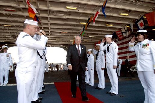 Sailors salute Vice President Dick Cheney as he departs the USS Ronald Reagan after the aircraft carrier's commissioning ceremony at the Norfolk Naval Station in Norfolk, Va., July 12, 2003.  White House photo by David Bohrer.