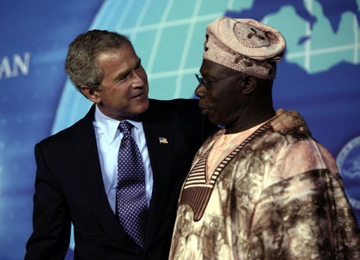 President George W. Bush with Nigerian President Olesugun Obasanjo after speaking at the Leon H. Sullivan Summit in Abuja, Nigeria on July 12, 2003. White House photo by Paul Morse.