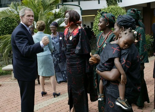 President George W. Bush talks with women who are members of Women and Children of Hope and the Nigerian Community of Western Living with AIDS at National Hospital in Abuja, Nigeria on July 12, 2003. White House photo by Paul Morse.