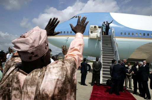 Nigerian President Olesugun Obasanjo waves to President Bush and Laura Bush as they depart from Abuja, Nigeria on July 12, 2003 White House photo by Paul Morse.