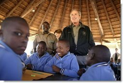 President George W. Bush talks to students attending nature classes at the Mokolodi Nature Reserve near Gaborone, Botswana Thursday, July 10, 2003.  White House photo by Paul Morse