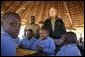 President George W. Bush talks to students attending nature classes at the Mokolodi Nature Reserve near Gaborone, Botswana Thursday, July 10, 2003. White House photo by Paul Morse.
