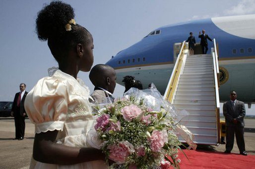 President George W. Bush and Mrs. Laura Bush arrive in Entebbe, Uganda Friday, July 11, 2003. White House photo by Paul Morse.