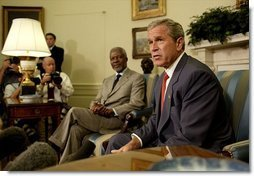 President George W. Bush and United Nations Secretary General Kofi Annan talk with the media during a meeting in the Oval Office Monday, July 14, 2003. They discussed President Bush's recent trip to Africa, and issues concerning Liberia and Iraq.  White House photo by Paul Morse