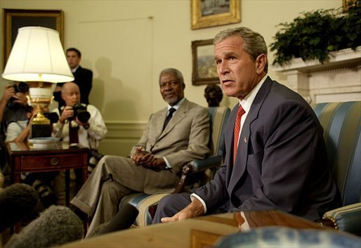 President George W. Bush and United Nations Secretary General Kofi Annan talk with the media during a meeting in the Oval Office Monday, July 14, 2003. They discussed President Bush's recent trip to Africa, and issues concerning Liberia and Iraq. White House photo by Paul Morse.